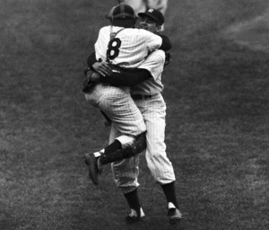 New York Yankees' catcher Yogi Berra leaps into the arms of pitcher Don Larsen after Larsen struck out the last Brooklyn Dodgers' batter to complete his perfect game during the fifth game of the World Series, Oct. 8, 1956. Racing up in the background is Joe Collins. (AP Photo)