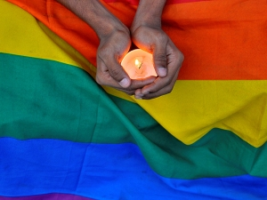 A member of the LGBT community in Bengalaru holds a candle during a memorial service following a mass shooting at the Pulse gay nightclub in Orlando, in India on June 14, 2016. Photo courtesy of REUTERS/Abhishek N.Cinnappa *Editors: This photo may only be republished with RNS-GUSHEE-OPED, originally transmitted on June 14, 2016.